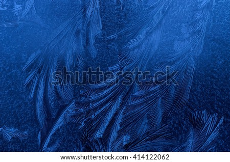 beautiful ice flower shapes and patterns on frost frozen window - stock photo