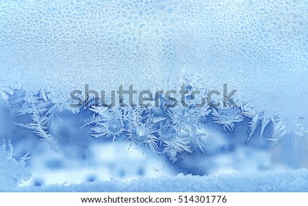 Beautiful ice pattern and frozen water drops on window glass