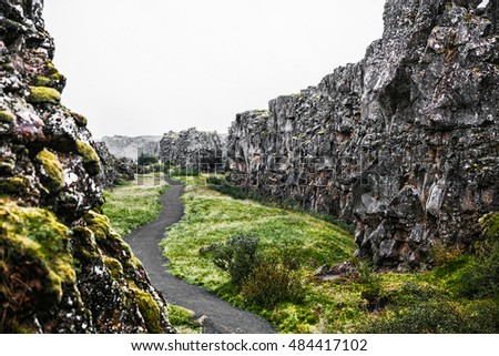 Beautiful icelandic landscape. Hiking trail in rocky canyon with green grass and moss. Icelandic summer