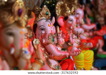 Beautiful idols of Lord Ganesha for sale in a Shop during Ganesh festival in India. - stock photo