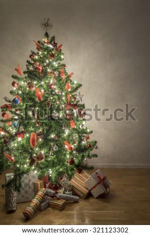 Beautiful illuminated christmas tree in a living room - stock photo