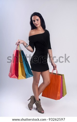 Beautiful illustration of a young woman posing with shopping bags