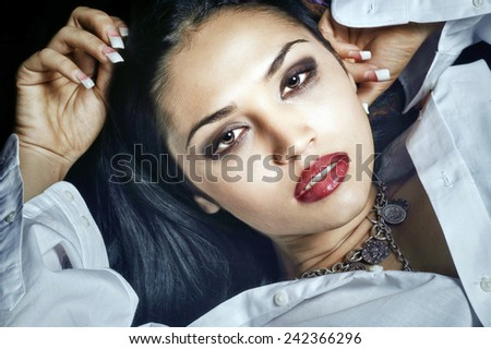Beautiful Image of a Latino Woman with mans shirt - stock photo