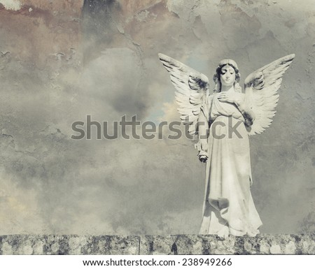 Beautiful image of an angel sculpture with a blue sky - stock photo