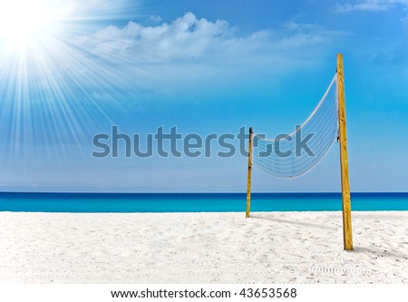 Beautiful image of beach volleyball court in Miami beach with blue sky and ocean waters in the background, on a sunny day - stock photo