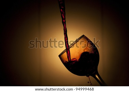 Beautiful image of the Pouring red Wine - stock photo