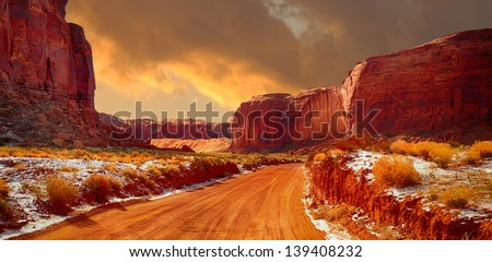 Beautiful Image of the road through monument valley in Winter - stock photo
