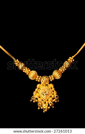 Beautiful Indian artwork displayed at a golden pendant - stock photo