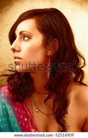 Beautiful indian brunette woman - golden portrait
