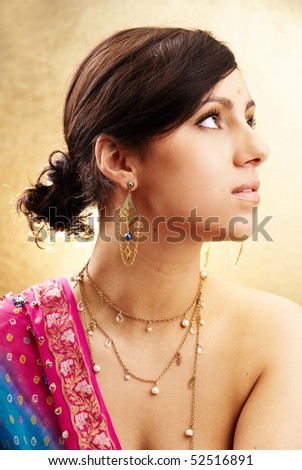 Beautiful indian brunette woman portrait with traditional costume