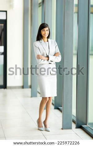 beautiful indian businesswoman in office looking at the camera - stock photo