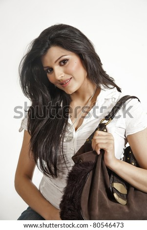beautiful Indian girl holding a hand bag - stock photo