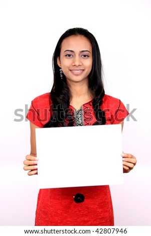 Beautiful Indian girl holding a white banner. - stock photo