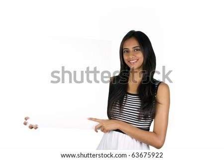 Beautiful Indian girl holding a white board. - stock photo