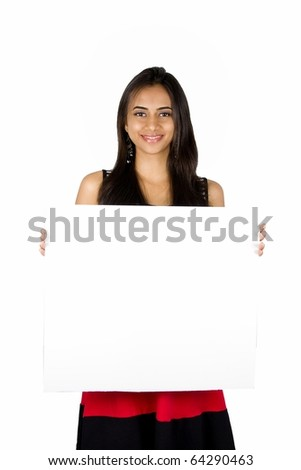 Beautiful Indian girl holding a white board.. Isolated on a white background. - stock photo