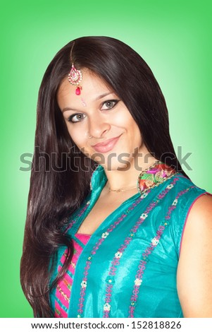 Beautiful Indian girl, portrait on green background