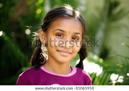 Beautiful Indian girl posing to the camera / Indian girl / Indian girl - stock photo