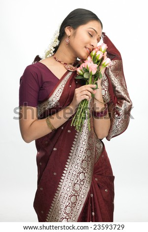 Beautiful indian girl with pink roses - stock photo