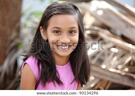 Beautiful Indian little girl posing to the camera.