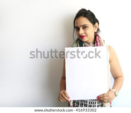 Beautiful indian woman holding a blank signboard, isolated on white background - stock photo