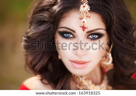 beautiful indian woman portrait bright makeup stock photo