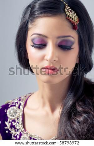 Beautiful indian woman with bridal makeup - stock photo