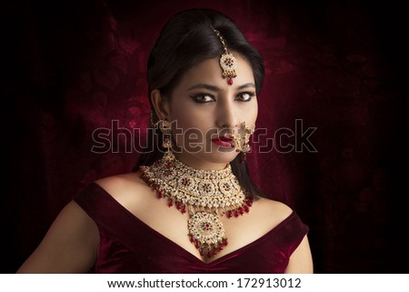 Beautiful Indian women portrait with jewelry - stock photo