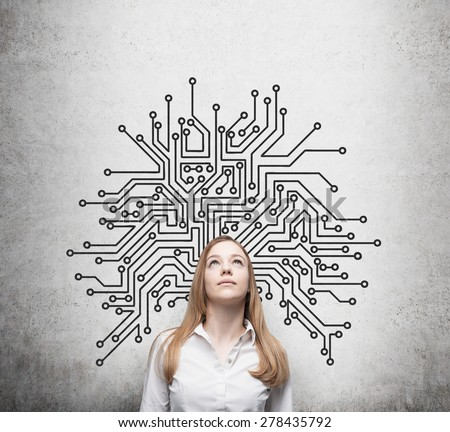 Beautiful information technology specialist is thinking about optimisation of the business process' structure. Microchip sketch behind the standing person. - stock photo