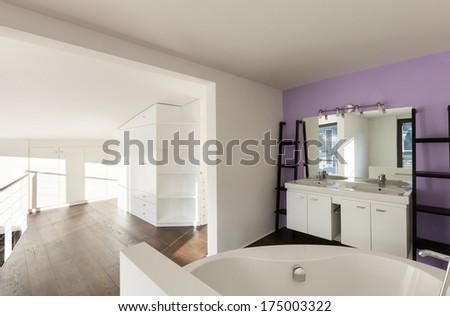 beautiful interior of a new apartment, view bathtub - stock photo