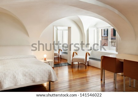 beautiful interior of hotel, apartment with double bed - stock photo