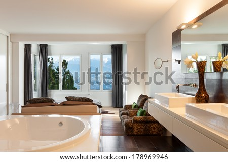 beautiful interiors of a modern house, bedroom - stock photo