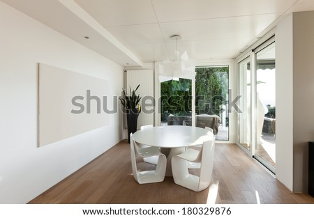 beautiful interiors of a modern house, dining room - stock photo