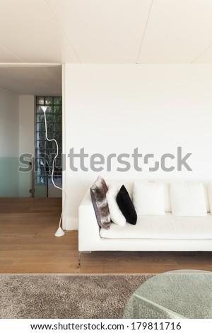 beautiful interiors of a modern house, living room, white divan - stock photo