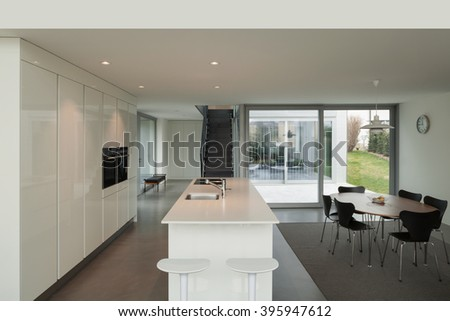 beautiful interiors of a modern house, white kitchen