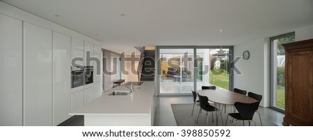 beautiful interiors of a modern house, white kitchen - stock photo