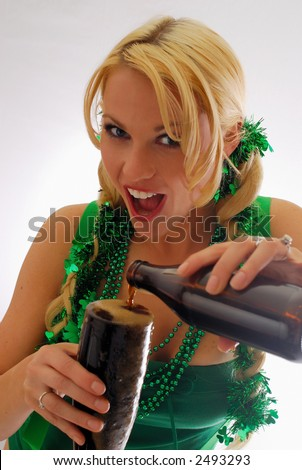 Beautiful Irish Lassie Pouring a Cold Pint of Ale copy space isolated - stock photo
