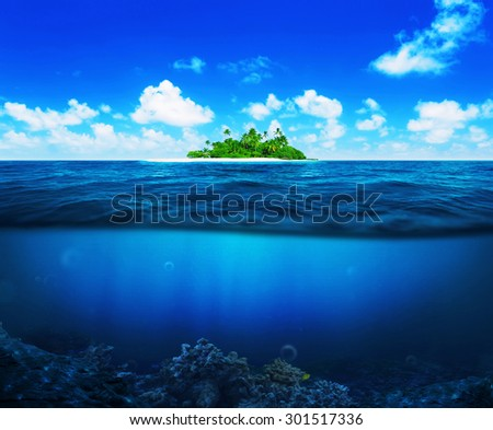 Beautiful island with palm trees in the ocean. Underwater - stock photo