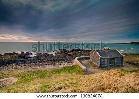 Beautiful Isolated Stone Hut Landscape on the Coastline of Aberdeen on a Stormy Morning in March - stock photo