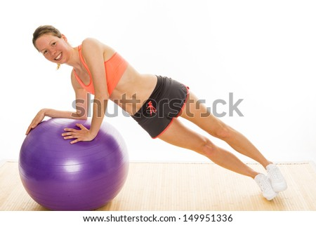 beautiful isolated young woman is doing some gymnastics exercises - stock photo