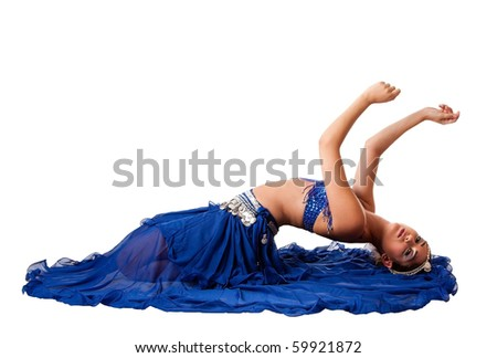 Beautiful Israeli Egyptian Lebanese Middle Eastern belly dancer performer in blue skirt and bra with arms in air laying bending backwards, isolated. - stock photo