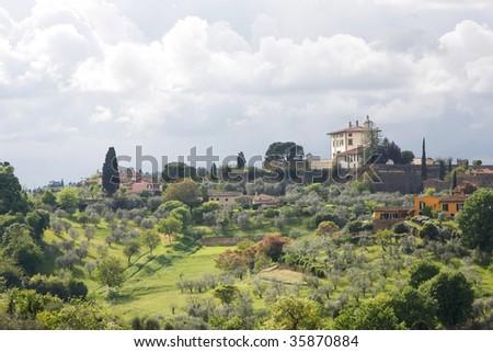 Beautiful Italian villas overlooking the Tuscan Hills - stock photo