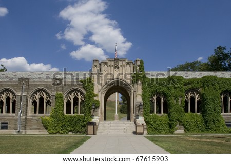 Beautiful ivy covered arched windows on the grounds of Cornell University in Ithaca, New York. - stock photo
