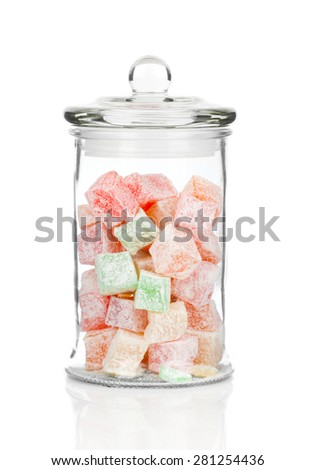 beautiful jar full of colorful delicious dessert Turkish delight, on a white background - stock photo