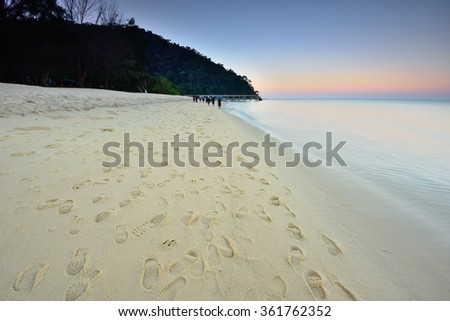 Beautiful Kerachut Beach in Penang Malaysia. Foot steps on the sand. Soft focus and nature composition. - stock photo