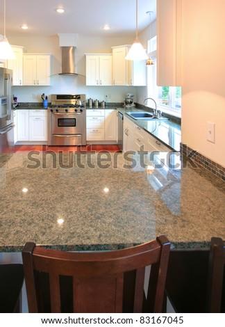 Beautiful Kitchen Interior in New Luxury Home - stock photo