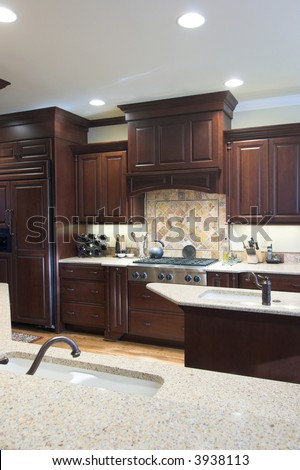 top of the line kitchen cabinets kitchen granite island cherry wood cabinetry stock photo 27251