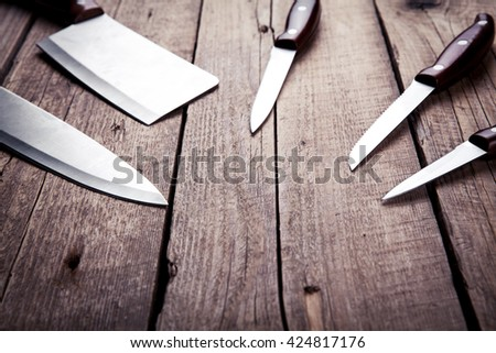 Beautiful knives with wooden handle, on an old table. Kitchen, cooking, cutting - stock photo