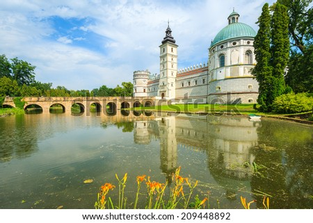 Beautiful Krasiczyn castle and lake on a sunny summer day, Poland  - stock photo