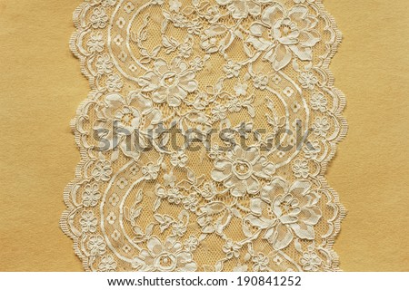 Beautiful lace on old paper - stock photo