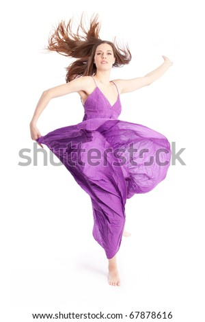 Beautiful lady dancing in a purple dress - stock photo